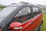 """相比欧力威的""""悬浮车顶""""设计,欧力威X6连车顶都涂成了黑色。"""